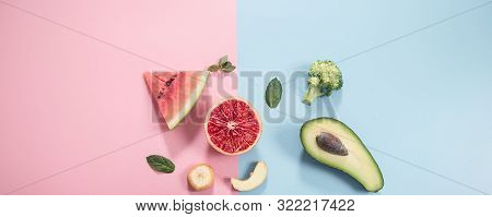 Different Fruits And Vegetables On A Colored Background.