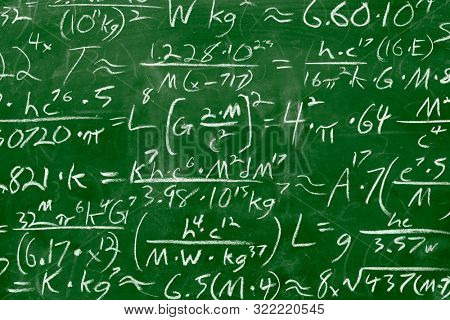 Math equations and formula written in chalk on green messy chalkboard background. School or scientific research concept.