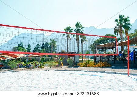 Volleyball Net And Tropical Background On Beach. Beach Volleyball.