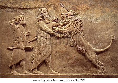 Assyrian Wall Relief, Detail Of Panorama With Royal Lion Hunt. Old Carving From The Middle East Hist
