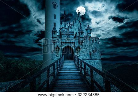 Lichtenstein Castle At Night, Germany. Old Spooky House In Full Moon. Creepy View Of Dark Mystery Ma