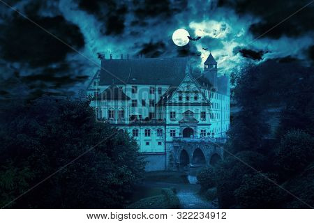 Haunted House At Night. Old Spooky Castle In Full Moon. Creepy View Of Dark Mystery Mansion With Bat