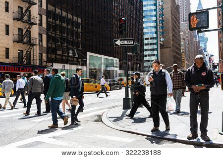 New York, Usa - Apr 27, 2016: Manhattan Street Scene. The Americans On The Streets Of New York City.