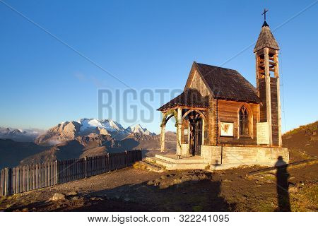 Small Wooden Church Or Chapel On The Mountain Top Col Di Lana And Mount Marmolada, Alps Dolomites Mo
