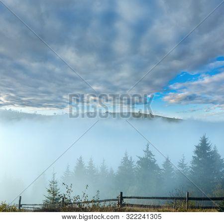 Misty Daybreak In Autumn Carpathian Mountain, Ukraine.