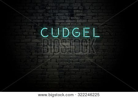 Highlighted Brick Wall With Neon Inscription Cudgel.