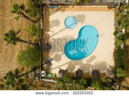 Drone Image, Birds Eye View About Blue Swimming Pools And Palm Trees, Plants Surrounded.