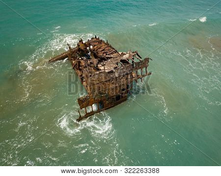 Rusty Ship Wreck Surrounded By Green Sea, Cyprus