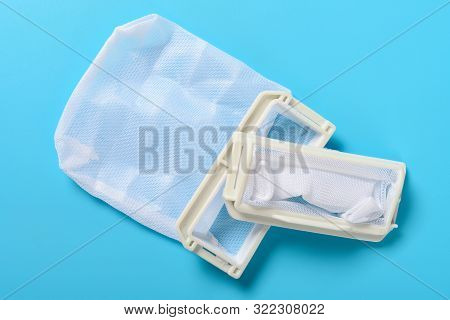 top view dust collectors for washing machine on blue background poster