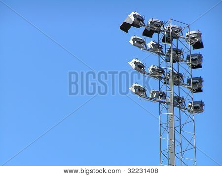 Stadium lights in blue sky