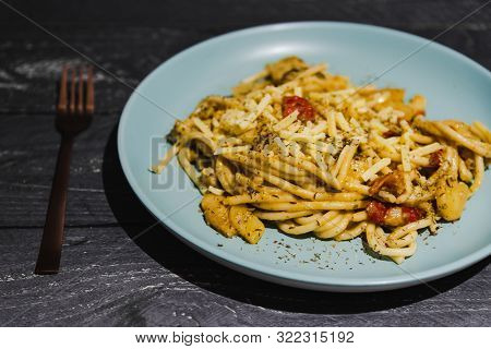 Bucatini Pasta With Tomatoes And Veggies And Vegan Cheese