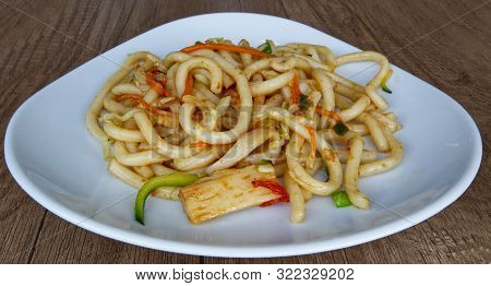 Fried Noodles And Vegetables. Asian Traditional Food: Yaki Udon Yasai