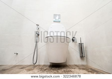 Wide Angle Photo Of Toilet Bowl In Water Closet On The Wall