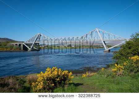 Connel Bridge And The Whirlpools Named The Falls Of Lora, Created By The Tide In Loch Etive As Water