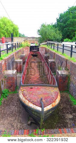 Old Narrow Boat Shell In Disused Canal Lock Chamber