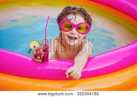 Children Playing In Pool. Child Water Toys. Stylish Sunglasses. Beach Clubs In Ibiza. Beach Party. C