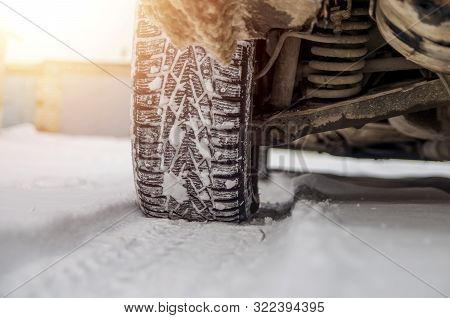 The Car Tire In The Snow Close Up. Car Tracks On The Snow. Traces Of The Car In The Snow. Winter Tir