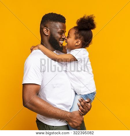 Pure Love. Lovely African American Daddy And Daughter Touching Noses And Cuddling, Orange Studio Bac