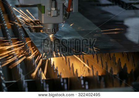 The Fiber Laser Cutting Machine Make Hole On The Sheet Metal Plate With The Sparkling Light. The Hi-