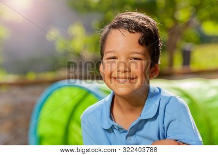 Summer Day Close Portrait Of A Smiling Cute Boy