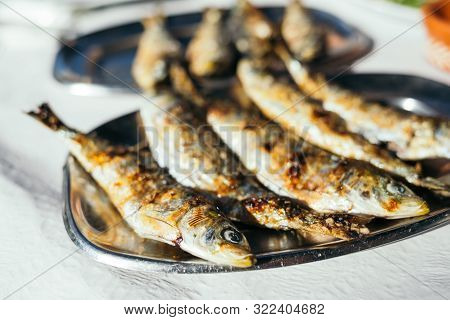 Traditional Portuguese Fried Sardines On The Plate.