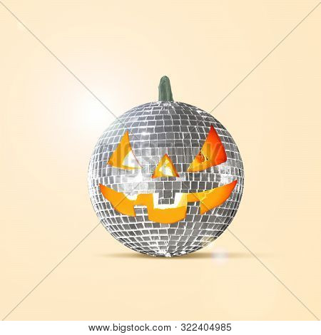 Scary Pumpkin On Yellow Background, The Night Of Fear. Modern Design With The Discoball. Halloween,
