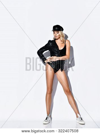 Brutal But Sensual Blonde Woman Trendsetter Is Posing In Bodysuit, Leather Jacket And Silver Shoes W