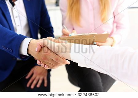 Businessman And Woman Shake Hands As Hello In Office Closeup. Friend Welcome, Introduction, Greet Or