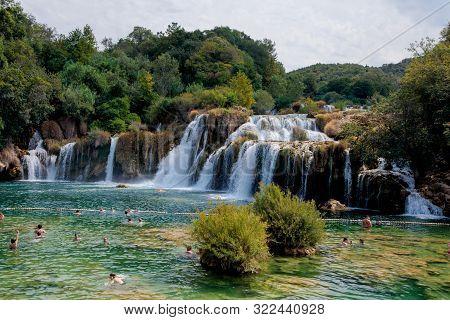 Krka National Park, Croatia - August 20, 2017: Plenty Of Tourists Enjoy Visiting Krka Waterfalls In