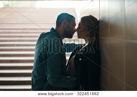 Sensual Couple Kissing In Underground Crossing. Love, Romantic, Passion Concept