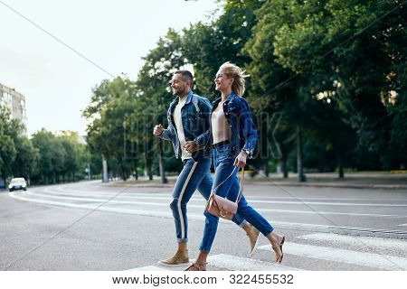 Young Happy Couple Running Crosswalk In The Street. Fun, Walking, Dating Concept