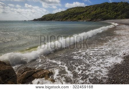 Crashing Waves At Pwll Du Bay On The Gower Peninsula In Swansea, South Wales, Uk, Once An Extensive