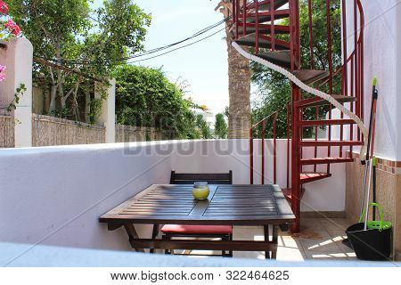 Summer Terrace With A Wooden Table And Chair In A House Of Rodalquilar, Almeria, Spain