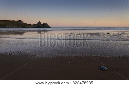 Evening At Three Cliffs Bay Gower A Barrel Jellyfish At Three Cliffs Bay, A Well Known Coastal Beaut