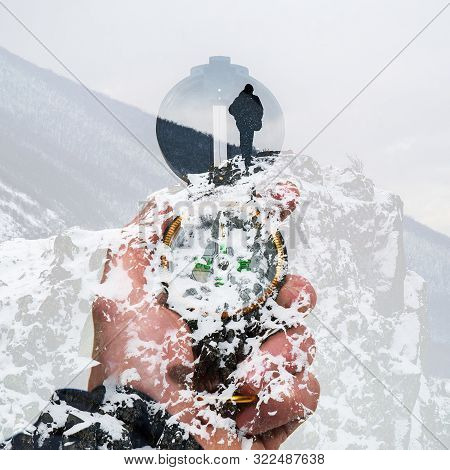 Compass In Hand On The Background Of A Winter Peak, Double Exposure