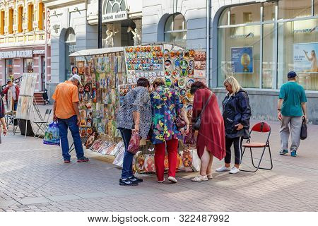 Moscow, Russia - September 13, 2019: People Near Stand With Russian Souvenirs On Arbat Street In Mos