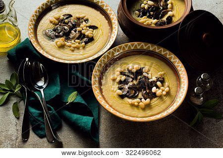 Mushroom Soup With Italian Cannellini Beans And Fennel In Clay Pots On A Table. Autumn Healthy Vegan