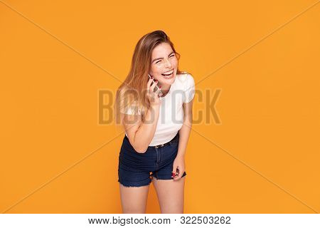 Laughing Happy Girl Talking By Mobile Phone.