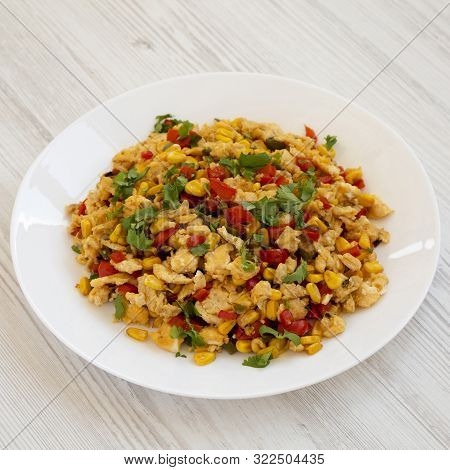 Homemade Southwestern Egg Scramble On A White Plate On A White Wooden Background, Side View. Close-u