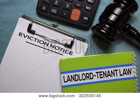Eviction Notice Text On Document Form And Book Landlord-tenant Law Isolated On Office Desk.