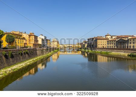 Firenze, Italy - August 13, 2019: famous historic Ponte Veccio in Florence at river Arno poster