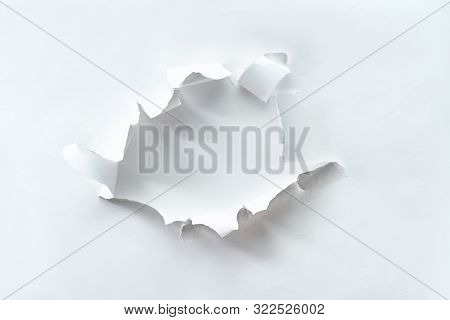 Teared Paper Hole In White Paper Over White Background For Your Text Or Product. Flat Lay, Overhead