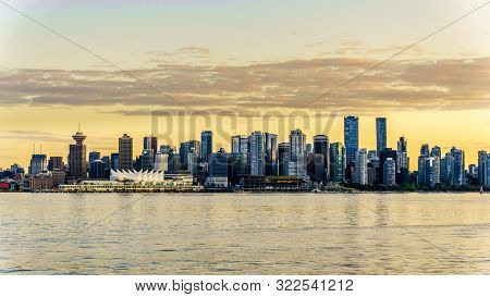 Vancouver, British Columbia/canada - July 11, 2019: Sunset Over The High Rise Buildings That Form Th