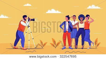 Professional Male Photographer Using Digital Dslr Camera On Tripod Shooting Mix Race Girls Posing To