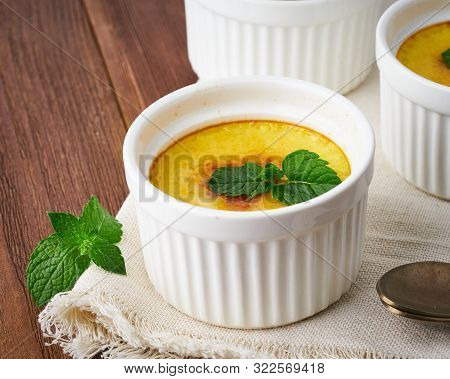 Crema Catalana, Spanish Dessert On Brown Wooden Table, Macro, Close Up, Side View