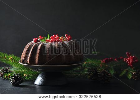 Christmas Homebaked Dark  Chocolate Bundt Cake Decorated With Powdered Sugar And Fresh Berries, Fron