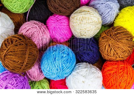 Set Of Colorful Wool Yarn Balls. Hanks Are Set Out In A Pile. Wool Yarn Rolls. Colorful Threads For
