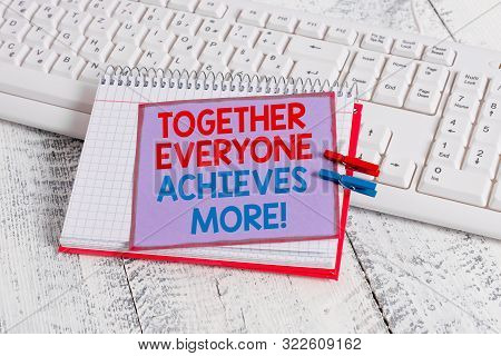 Word writing text Together Everyone Achieves More. Business concept for Members create synergy with strong sense mutual commitment notebook paper reminder clothespin pinned sheet white keyboard light wooden. poster