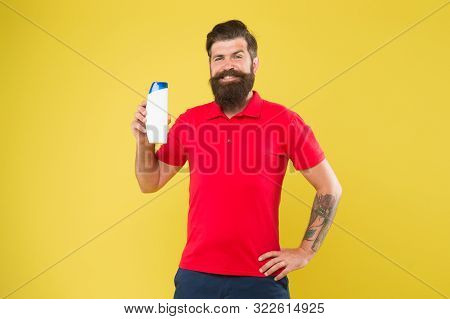 Expert care for demanding hair. Shampoo for hair type. Make hair stronger. Man handsome bearded hipster hold bottle shampoo shower gel. Shampoo conditioner for men. Plastic container with shampoo. poster