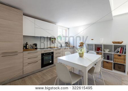 Very nice kitchen with design table and chairs. Nobody inside